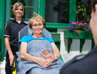 portrait of a nurse and a patient smiling
